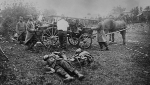 Soldiers collecting dead comrades from battlefields