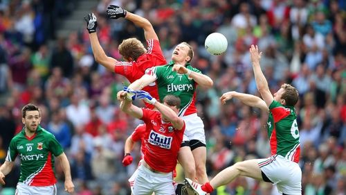Mayo's Donal Vaughan and Colm Boyle vie for possession with Ian Maguire and Fintan Goold of Cork
