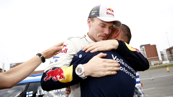 Jari-Matti Latvala hugs a member of his team as he celebrates victory