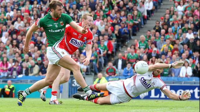 Aidan O'Shea beats lunging Cork keeper Ken O'Halloran for Mayo's only goal of the game at Croke Park