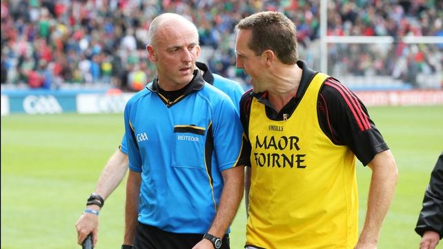 Cork selector Ciaran O'Sullivan confronts referee Cormac Reilly