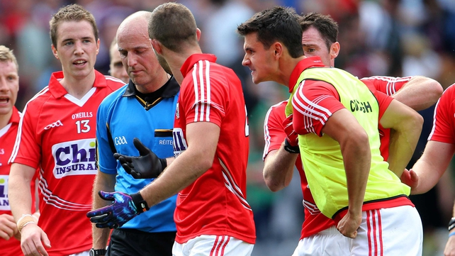 Cork players remonstrate with referee Cormac Reilly at full-time, including Tomas Clancy (bib), who was black carded earlier in the game
