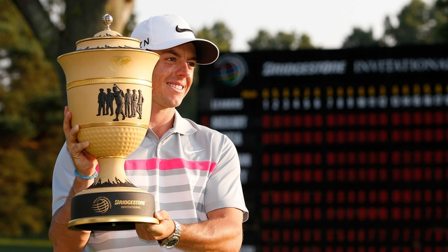 Rory McIlroy holds the Gary Player Cup after winning the World Golf Championships-Bridgestone Invitational