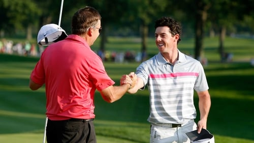 Rory McIlroy celebrates with caddie JP Fitzgerald after his winning putt in the final round of the World Golf Championships