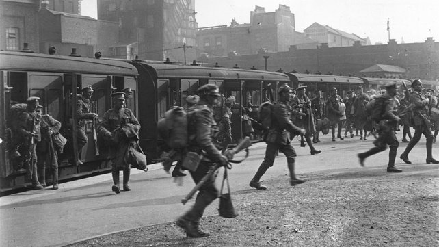 Troops leaving railway carriages at Victoria Station, London