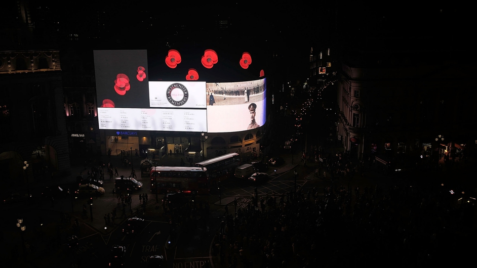 Piccadilly Circus displayed memorial images as the lights were turned off