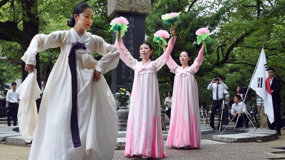 South Korean women dance during a memorial service for the victims of the 1945 atomic bombing