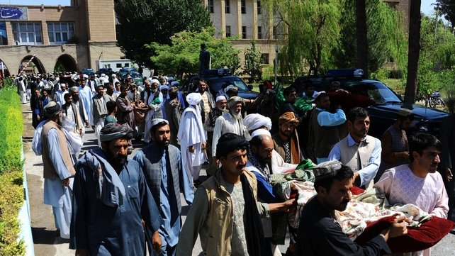 Afghan mourners carry the bodies of civilians killed in a NATO-led air strike in Herat