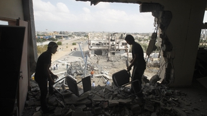 Palestinians salvage their belongings from their destroyed home in Rafah