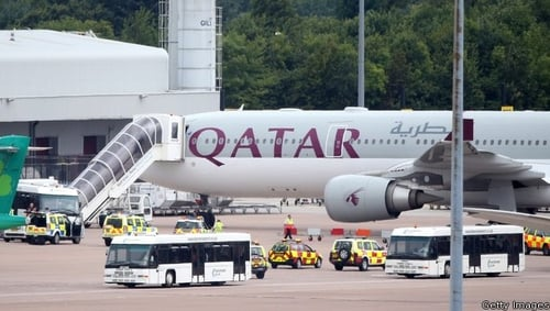 The Qatar Airways plane on the tarmac in Manchester Airport after it landed