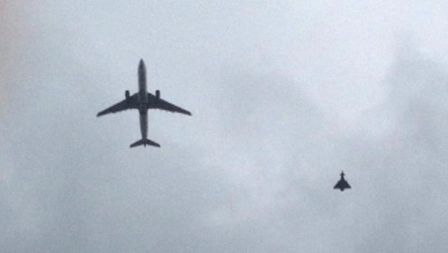 An RAF fighter jet escorted the passenger plane into Manchester Airport