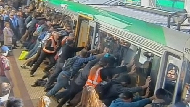 Commuters in Perth tilted the train so the man could be freed