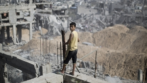 A boy looks out at the destruction in part of Gaza's al-Tufah neighbourhood