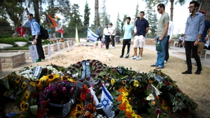 Wreaths on the grave of an Israeli soldier killed in the fighting as people pay tribute at the military cemetery on Mount Herzl, Jerusalem