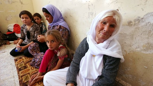 Thousands of Yazidi families have fled violence in the northern Iraqi town of Sinjar