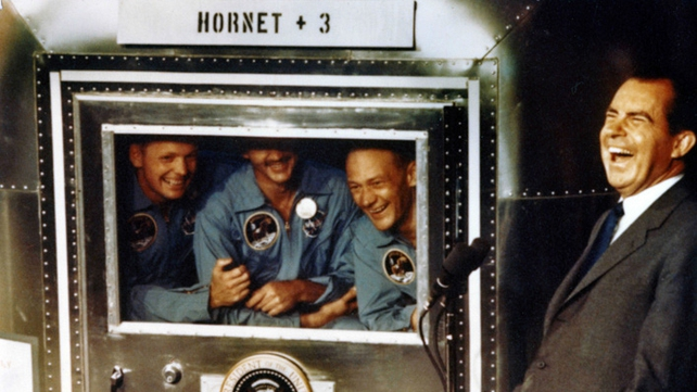 Apollo XI astronauts Neil Armstrong, Michael Collins and Buzz Aldrin laugh with President Nixon aboard the USS Hornet on 24 July 1969