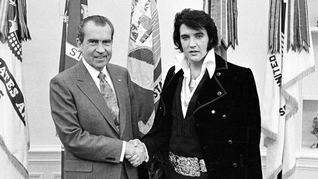 Nixon meets with Elvis Presley at the White House on 21 December 1970