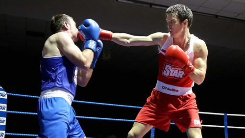 Darren O'Neill (red) fights in place of the injured Joe Ward