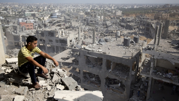 A boy surveys the damage from the Israeli military campaign in Gaza City
