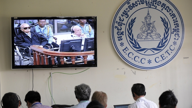 Cambodian and international journalists watch a live feed of the court proceedings in Phnom Penh