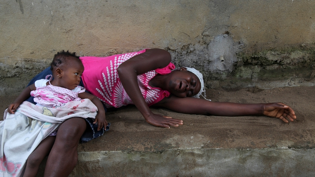 A woman weeps after the death of a relative in the Banjor Community near the capital Monrovia