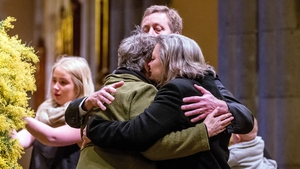 Grieving relatives comfort each other at a memorial service in Melbourne for the Australians who died when Flight MH17 was shot down