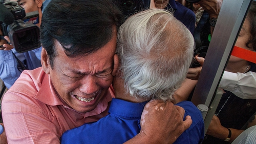 Two survivors cry after hearing the guilty verdict