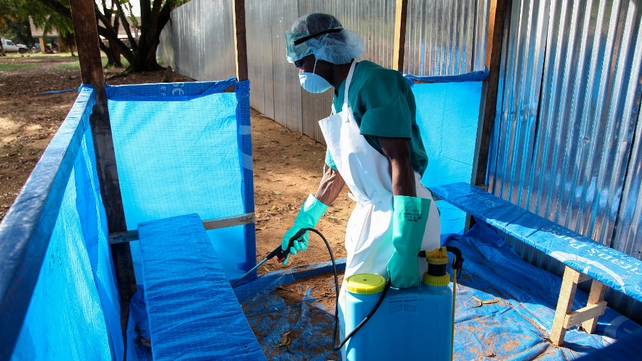 A health worker sprays the inside of a treatment centre