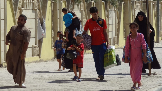 Iraqis displaced by ongoing conflict arrive in Kirkuk
