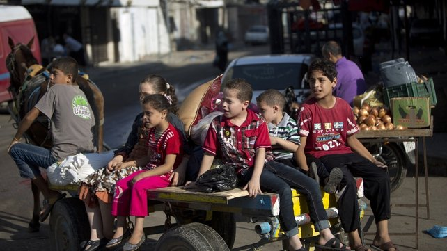 Palestinian families are leaving their homes in Gaza City in anticipation of Israeli air strikes