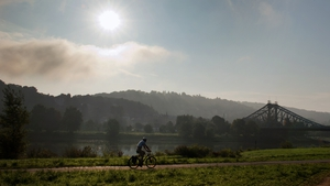 A man cycles by the river Elbe in Dresden, Germany