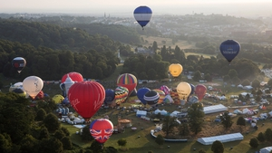 Hot air balloons depart from Aston Court on the first full day of the Bristol International Balloon Fiesta