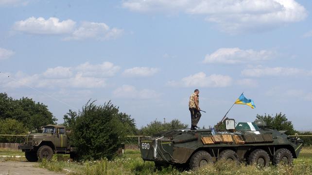 Ukrainian servicemen from the Donbass volunteer battalion prepare for redeployment