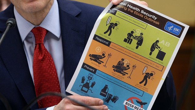 US Centers for Disease Control and Prevention Director Tom Frieden shows an awareness poster