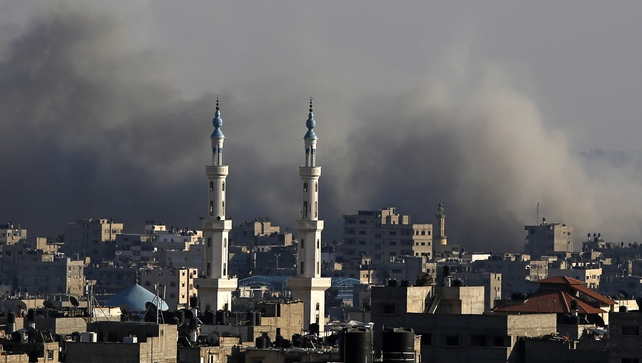Smoke rises after Israeli air strikes in the north of Gaza City