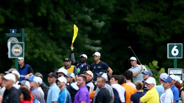 All eyes are on McIlroy's tee shot on the sixth
