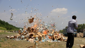 An Afghan official burns expired drugs in Jalalabad, Afghanistan.