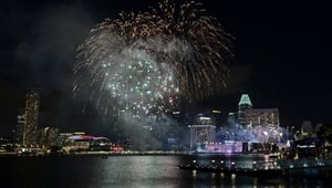 Fireworks burst above the skyline of Singapore as the city celebrates its National Day.