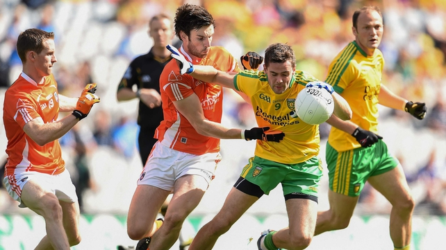 Donegal's Odhran Mac Niallais holds off the Armagh defence