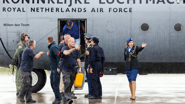 Members of the repatriation mission who were active in the area of the MH17 plane crash arrive at the Eindhoven airbase