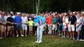 Battling McIlroy retains lead at US PGA