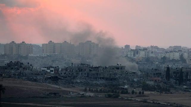 Smoke rises from Gaza City as Israeli tanks gather on the Gaza border