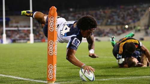 Joe Tomane touches down spectacularly for the Brumbies