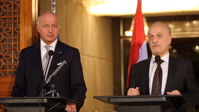 French Foreign Minister Laurent Fabius holds a press conference with Iraqi deputy prime minister Hussein al-Shahristani