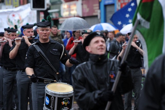 The parade passed through the city centre, loyalists threw fireworks and plastic bottles