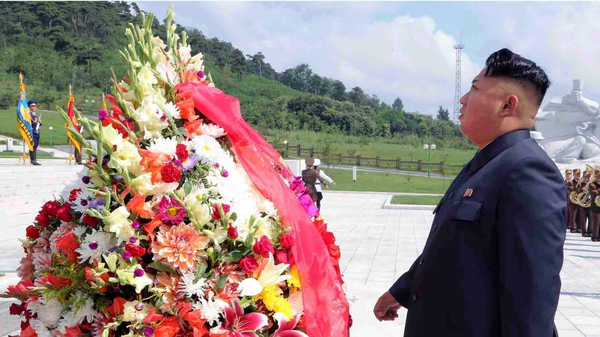 North Korean leader Kim Jong-un visiting the Korean War veterans cemetery in Pyongyang