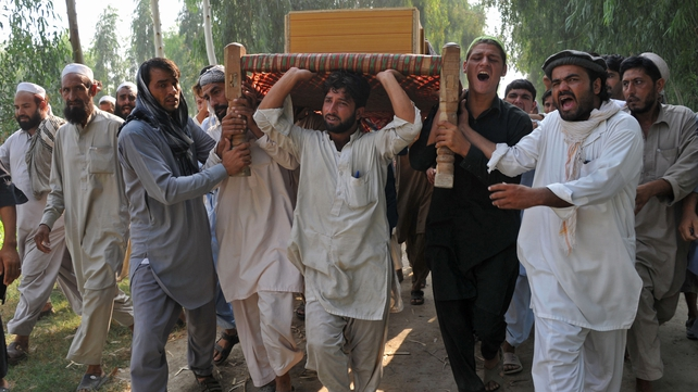Afghan men carry the coffin of a civilian, allegedly killed in a NATO air strike, on the outskirts of Jalalabad last year