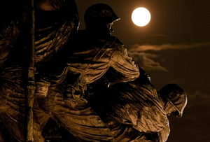 The supermoon rises above the US Marine Corps War Memorial in Arlington, Virginia