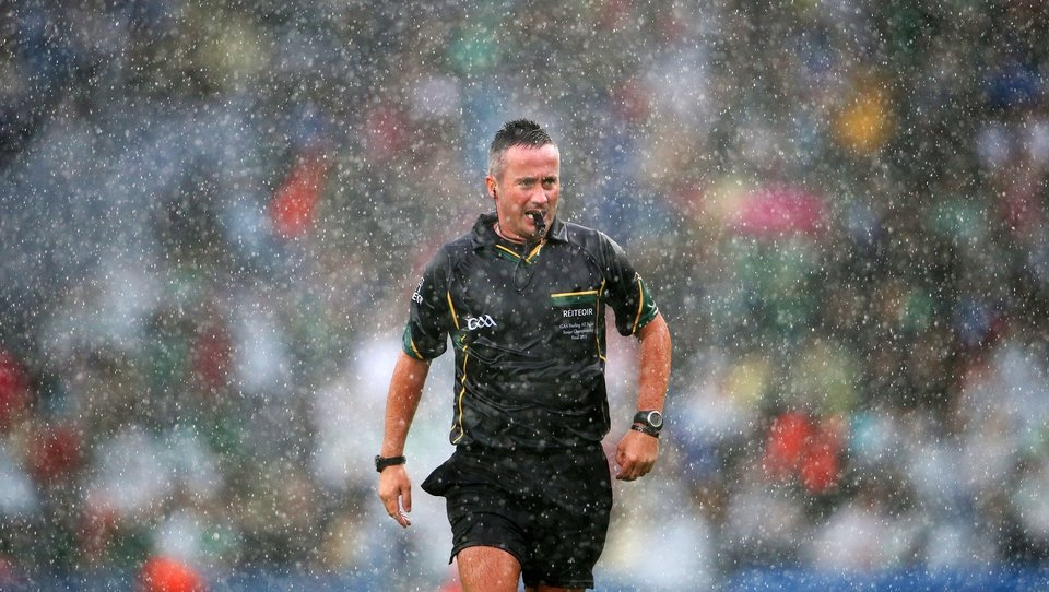 Referee James McGrath has some difficult calls to make with conditions making things that much more difficult
