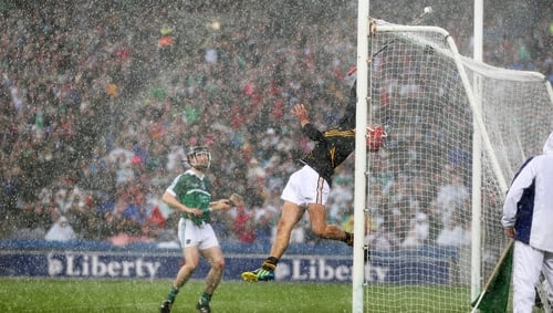 The sliotar just goes over Kilkenny goalkeeper David Herity and the bar